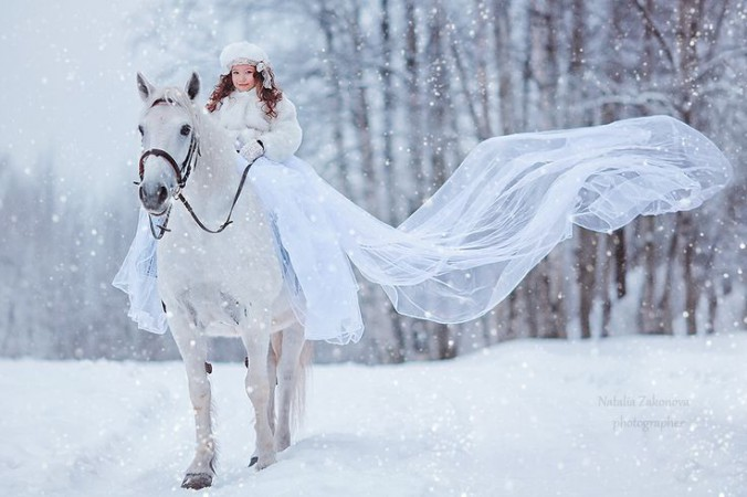bride on horse in snow