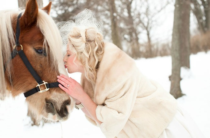 bride with birdcage veil and horse
