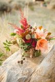 peach and red rustic flower centerpiece