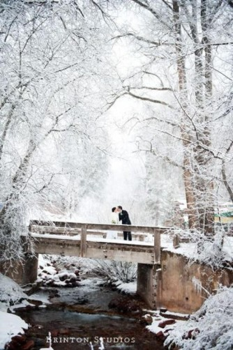 winter wedding on a bridge with snow